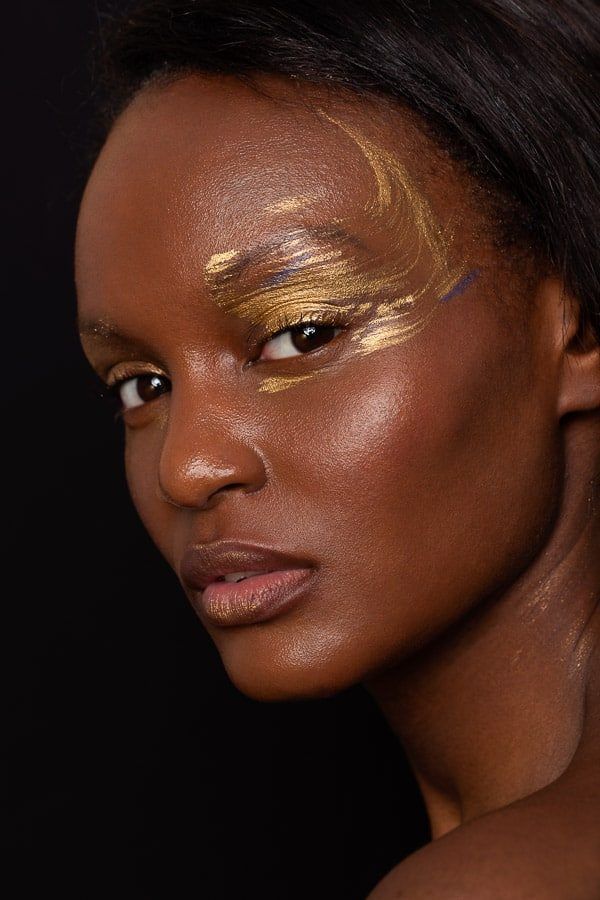 Gold and blue eye creative makeup